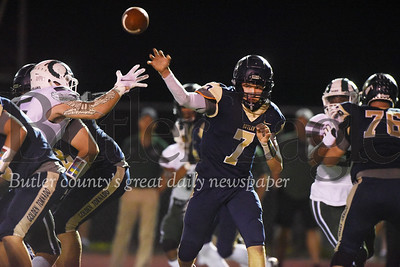 Harold Aughton/Butler Eagle: Butler quarterback Cooper Baxter attempts a lateral pass in the second quarter against Pine-Richland