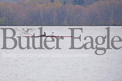 Rosemary Kenny(Left), Claudia White and other members of the North Catholic crew team had Lake Aurther to themselves for practice Monday. Seb Foltz/Butler Eagle