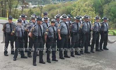 Troopers stand at ease during Friday's State Police Day ceremony at Troop D barracks in Butler Township. The event recognizes the Pennsylvania State Policeand honors troopers killed in the line of duty.