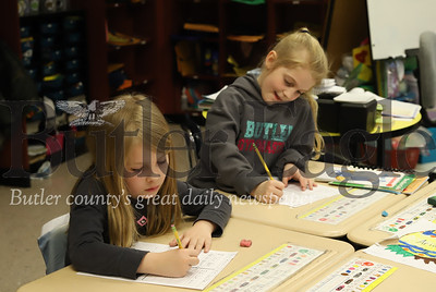 McQuistion Elementary first graders Emily Mcandles (Left)  Harlow Jensen (Right) work on their Mother's Day letters.Seb Foltz/Butler Eagle