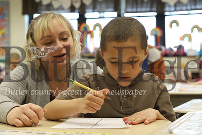 McQuistion Elementary teacher Rene Ruffner helps first grader Kayden Ellis with his Mother's Day note. Seb Foltz/Butler Eagle