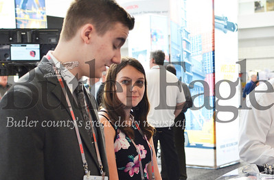 On the right, Emilie Jones, 16, a junior at Knoch High School listens to her classmate, 17-year-old junior Kade Hilterman, speak to exhibitors at the 2019 Association for Iron and Steel Technology Conference in Pittsburgh. Tanner Cole/Butler Eagle