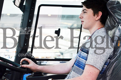 Alex Olczak, 16, a sophomore at Karns City High School sits in the driver's seat of a Toplift Ferrari heavy duty forklift at the 2019 Association for Iron and Steel Technology Conference in Pittsburgh. Tanner Cole/Butler Eagle