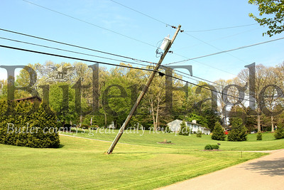 A utility pole fell over while an Armstrong cable person was working on it, causing a nearby utility pole to become partially dislodge. The cable worker was taken to a nearby hospital as a precaution.