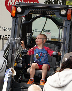 Photo by J.W. Johnson Jr. Mason Vanderhoof of Zelienople plays on a piece of equipment Saturday at the annual Big Truck Day in Zelienople Community Park.