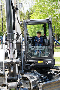 Photo by J.W. Johnson Jr. A.J. Casoli of Monaca plays on a piece of equipment Saturday at the annual Big Truck Day in Zelienople Community Park.