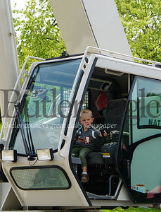 Photo by J.W. Johnson Jr. Courtland Mozer of Mars plays in a crane Saturday at the annual Big Truck Day in Zelienople Community Park.