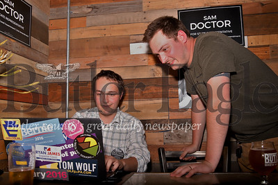 State congressional candidate Sam Doctor (right) tracks early election results with campaign manager Sawyer Neal at their election night event at Butler Brew Works. Seb Foltz/Butler Eagle