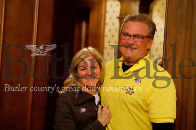 """William """"Wink"""" Robinson and his wife Suzanne host family, friends and campaign volunteers eagerly awating election results Tuesday night at Robinson's law office and campaign headquarters. Seb Foltz/Butler Eagle"""