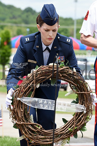 Harold Aughton/Butler Eagle: Rachel Harrington places a wreath in memory of those who served in the Merchant Marines during the Memorial Day ceremony held at the North Boundary Park in Cranberry Twp. Sunday, May 26.