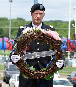 Harold Aughton/Butler Eagle: Steve Milhalacki of Cranberry carries a wreath in memory of those who served in the Coast Guard during the Memorial Day ceremony held at the North Boundary Park in Cranberry Twp. Sunday, May 26.