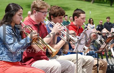 Harold Aughton/Butler Eagle: Seneca Valley High School students, (left -right) Sydni Roller, Jeremy Love, Matt Miller, Daniel Simoes play taps to conclude the Memorial Day Ceremonyat the North Boundary Park in Cranberry Twp.