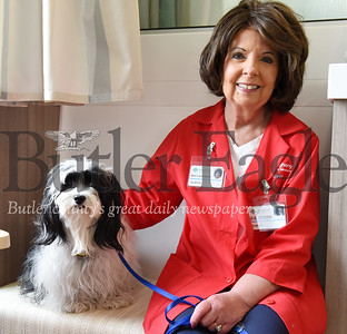 Harold Aughton/Butler Eagle: Mary Louise Boben and her therapy dog, G.G. (AKA: God's Gift) have been visiting cancer patients at the AHN Cancer Center once a week for the past year