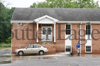 Harold Aughton/Butler Eagle: Gerry Otteni, a trustee of the Gospel Life Church in Evans City pumps out water from the church basement Wednesday, May 29.