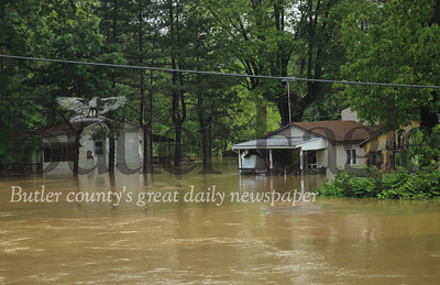 Floods engulfed houses along the Connoquenessing Creek with many residents fleeing their homes before being trapped by the rising waters. Houses pictured here are situated off Textor Road in Jackson Township.