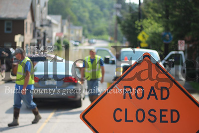 Flooded roads redirected traffic throughout the county Wednesday. Mercer Street in Harmony, pictured here, was underwater for much of the morning.