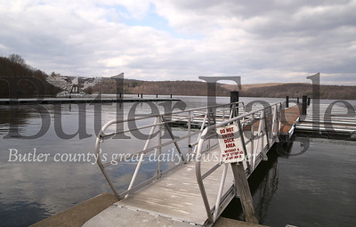 With the access road blocked off, the docks remain empty at Moraine State Park's marina and boat rental at Cresent Bay on the North Shore during the COVID-19 outbreak. Photo Saturday 4/18/20  Seb Foltz/Butler Eagle