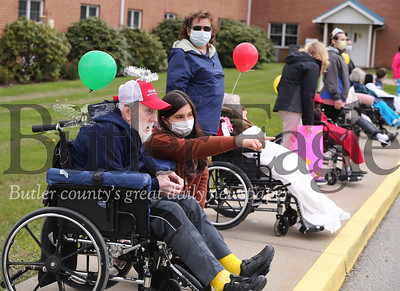 Residents of Concordia's Lund Care Center line up to wave at family passing buy in a parade of cars. With concerns for spreading COVID-19 families stayed in their cars for the brief drive by visit. It was the first time residents were able to see family members in person since the lock down. Seb Foltz/Butler Eagle