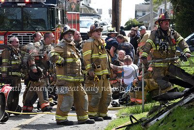 Harold Aughton/Butler Eagle: Butler City firefighters assess the damage to house at the intersection of Fairview and Glenn Avenues in Butler, Saturday, May 2, 2020.
