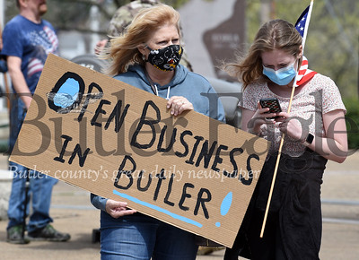 Harold Aughton/Butler Eagle: Nancy Albert of Penn Twp. and her granddaughter, Chloe Panei, 16, of Butler, joined about 50 protestors and bystanders in Diamond Park Saturday afternoon to protest Gov. Wolf's decision not to open Butler County.