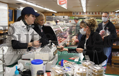 Kylie Thoma of Thoma Meat Market rings upHeather Mann Friday 05/01/20. The market reopened Friday for the first time since the beginning of the COVID lockdown. Prior to Friday the market had been doing curbside pickup. Seb Foltz/Butler Eagle