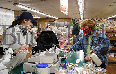 Kylie Thoma of Thoma Meat Market rings up Debbie Rettig of Cabot Friday 05/01/20. The market reopened Friday for the first time since the beginning of the COVID lockdown. Prior to Friday the market had been doing curbside pickup. Seb Foltz/Butler Eagle