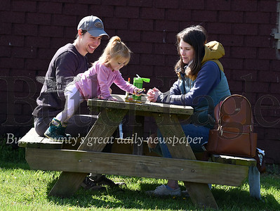 Harold Aughton/Butler Eagle: Daniel Glaser, his wife, Emma, and 2-year-old daughter Madeline decided to picnic with Freedom Farm donuts and a coloring book at Succup Nature Park in Penn Twp. Saturday morning, May 2, 2020.