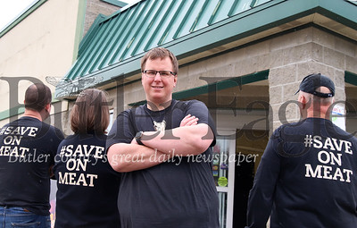 Doug Sprankle of Sprankle's Neighborhood Market stands in front of the old Freidman's grocery store in Saxonburg with this family Friday. The family-owned grocery chain will be expanding to the Saxonburg location with Doug Sprankle taking over operations of the store. He told the Butler Eagle that they plan to open in July. Seb Foltz/Butler Eagle