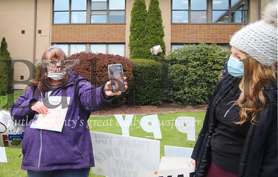 Peggy Wilson (left) holds up her phone for her mom Carol Kremer to Facetime with Kremer's granddaughter Caitlin Shaw and other family family gathered for Kremer's birthday at Sunnyview Nursing and Rehabilitation Center. Kremer was able to wave and see family from a second story window in the facility. Seb Foltz/Butler Eagle