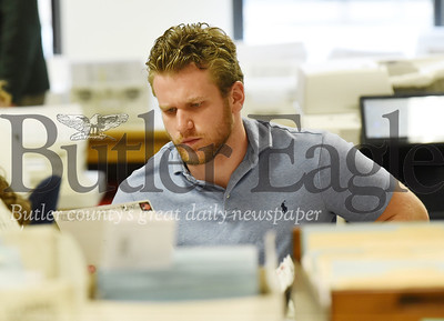 Harold Aughton/Butler Eagle: Tim Vernick, a temporary worker at Butler's bureau of elections, sorts through the ballot applications Monday afternoon, May 11, 2020.