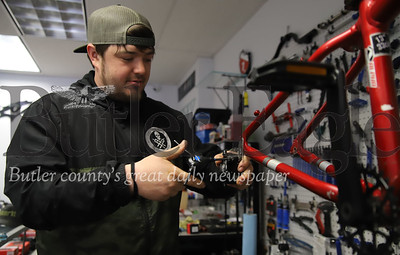 Gilly's Wheel House co-owner Josh Gilliland works on a bike Friday at their Main St. bike shop in Butler. Gilliland said they've seen a bump in bike-repair during the COVID epidemic which he credits to more people getting outdoors during the shutdown. Seb Foltz/Butler Eagle