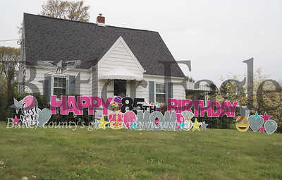 Jim and Cooky Diamond were greated with a surpise from their daughter Teresa Thursday morning. She arranged to have a birthday sign celebrating Cooky's 85th birthday setup on their front lawn. The Diamonds have been self-isolating  and taking other precautions due to the COVID-19 pandemic, including having Teresa  deliver their groceries. Seb Foltz/Butler Eagle