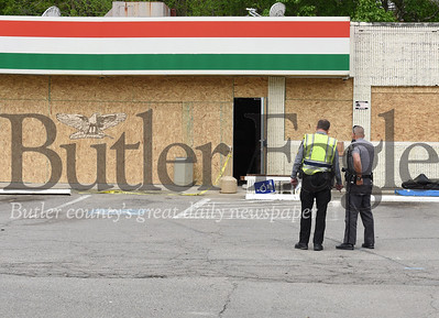 Harold Aughton/Butler Eagle: Corporal Brandt of the Pennsylvania State Police in Butler, and officer Conrad Pfeifer of the Middlesex Police department worked together to reconstruct the deadly accident that occurred early Sunday morning at the GOGO's along Rt. 8 in Middlesex Township.