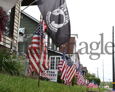 Flags line the road and sidewalk  at a home on East Jefferson St. outside of Butler. Seb Foltz/Butler Eagle