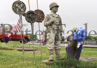 A soldier statue stands watch over the grave of Robert Sankey at the Calvary Cemetary in Butler. Seb Foltz/Butler Eagle