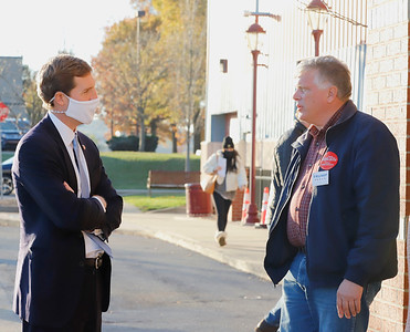 U.S. Rep. Conor Lamb (D, left) speaks with republican volunteer Paul Adametz and a Cranberry area voter outside of the Cranberry Township Municipal Center Tuesday. Seb Foltz/Butler Eagle 11/03/20