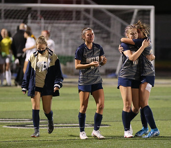 Butler's Chloe Weiland (6) Stephanie Adkisson (18) and Sydney Shuster (31) walk off the field together following the team's WPIAL Championship loss to North Allegheny. The Golden Tornado lost to NA in double overtime 2-1. Seb Foltz/Butler Eagle 11/05/20