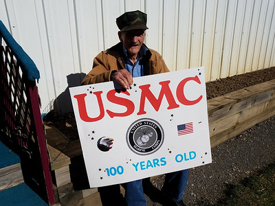 Karl Herold, 99, shows of the sign he was going to use in the since-canceled Veterans Day parade Wednesday. The former Marine turns 100 Dec. 29. ERIC FREEHLING/BUTLER EAGLE