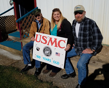 From left, Dorothy, Karl and David Herold show off the sign that Karl Herold wanted to display in Wednesday's canceled Veterans Parade. ERIC FREEHLING/BUTLER EAGLE