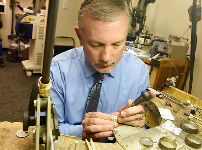 Harold Aughton/Butler Eagle: Stephan Goslaw of Robert Stephens Custom Jewelers, works on a piece of jewelry.