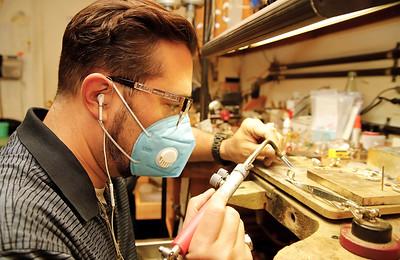 Gregg Eichhorn of Mathew Jewelers works on a ring. Seb Foltz/Butler Eagle