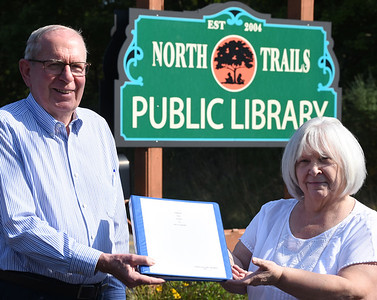 Harold Aughton/Butler Eagle: Former County Commissioner Bill McCarrier presented his book of West Sunbury to North Trails librarian Kathy Kline Wednesday, Sept. 9, 2020.