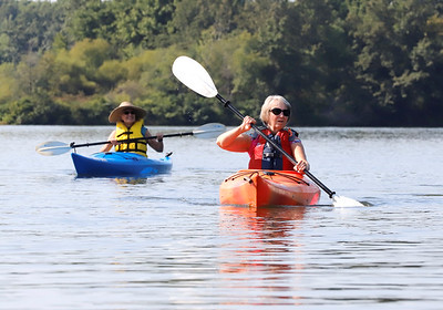 Gayle Lenihan of Grove City kayaks on Lake Arthur with Ruth Fertelmes of Cabot Wednesday during a tour with environmental education staff at Moraine State Park. Seb Foltz/Butler Eagle 09/09/20