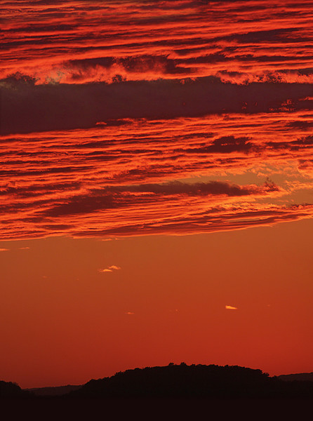 3 Jan: This sunset covered a full third of the western sky with reds and pinks,  but all I had was a 400mm lens. This is a three-shot vertical panorama - if it's possible to have a long-lens panorama...