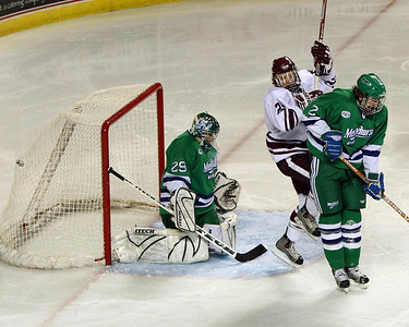 11/14/04 Kevin Jarman creates traffic up front for a Marvin Degon (not pictured) goal against Mercyhurst on Sunday night.  Minutemen go on to win 6-1