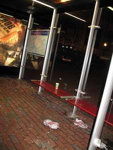 Shoes at an MBTA bus stop