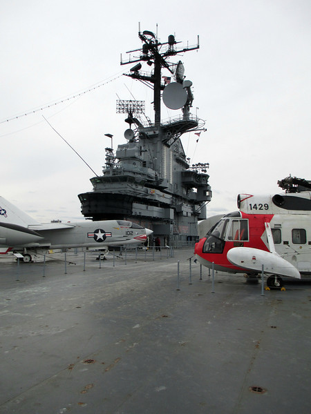 """""""USS Intrepid Flight Deck, New York"""" - Daily Photo - 05/20/13<br /> <br /> As a kid, I made models of this vessel in the World War II configuration and of a sister ship the USS Hornet in this refitted more up-to-date version, so I was familiar with the layout.  It was quite a thrill wandering around the decks and getting a sense of the history that has occurred here.  I'm an equipment and weapons nut spending hours aboard loving every minute.<br /> <br /> <br /> <a href=""""http://www.ussintrepid.com/voyage.html"""">http://www.ussintrepid.com/voyage.html</a><br /> <br /> Timeline from the website:<br /> <br />   *  December 1, 1941: Intrepid's keel laid at Newport News, Virginia.<br />   *  December 7, 1941: Japanese attack Pearl Harbor.<br />   *  April 26, 1943: Launched.<br />   *  August 16, 1943: Commissioned CV-11.<br />   *  December 3, 1943: Sailed for Pearl Harbor via the Panama Canal and San Francisco.<br />   *  January-February, 1944: Participated in the Marshall Islands invasion.<br />   *  February 1944: Participated in raid on Truk.<br />   *  February 17, 1944: Damaged by Japanese aerial torpedo.<br />   *  September-October 1944: Participated in attacks on invasion of the Palaus.<br />   *  Strikes against the Philippines, Formosa, and Okinawa.<br />   *  Operated out of Utilic fleet anchorage in the Carolinas as unit of Task Force 38.<br />   *  October 24, 25, 26, 1944: Participated in Battle of Leyte Gulf.  Helped sink the super-battleship Musashi.<br />   *  October 30, 1944: Hit by kamikaze--slight damage.<br />   *  November 25, 1944: Hit by two kamikazes--heavily damaged.<br />   *  March 1945: Strikes against Tokyo and Okinawa. Near miss by a Japanese heavy bomber kamikaze.<br />   *  April 6, 1945: Helped sink the Japanese super-battleship Yamato.<br />   *  April 16, 1945: Damaged during invasion by kamikaze attack off Okinawa.<br />   *  August 1945: Reported back to the Fast Carrier Force.  War ended.<br />   *  August-December 1945: Policed t"""