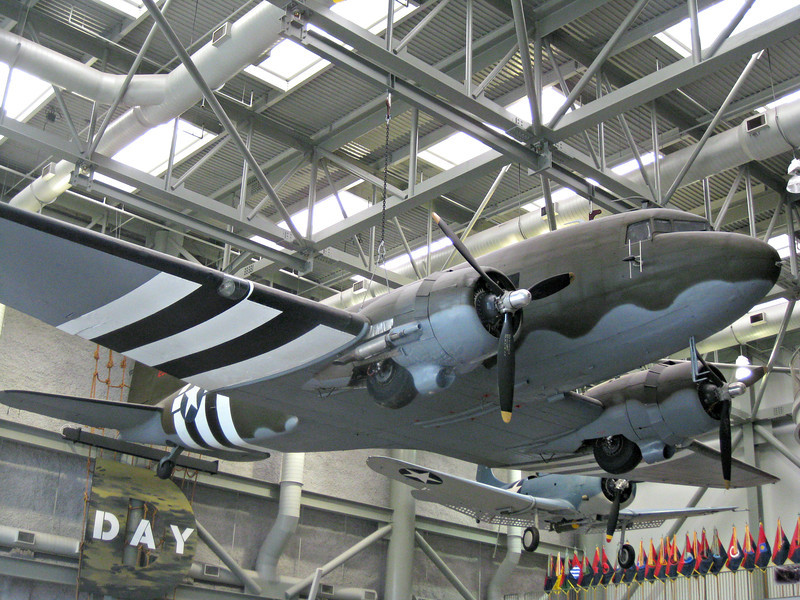 """""""In Rememberance of D-Day: Douglas C-47, Louisiana Memorial Pavilion, The National World War II Museum, NOLA"""" - Daily Photo - 06/06/13<br /> <br /> The plane photographed is of one of the most significant transports of the war and the civilian version the DC-3 was the workhorse for the early commercial airlines.  Painted in the black and white invasion stripes, this photo was taken during the annual D-Day Anniversary held at the museum in 2012.  While dated, I thought it was appropriate to include the C-47 for the """"daily"""" in commemoration of the day.  This was also the aircraft that my father-in-law maintained in the Aleutian Islands during World War II.  He left or ran you may say from a poor coal mining town in Pennsylvania to a icy barren rock in the Northern Pacific.  Al and I """"bonded"""" over this type of plane at an airshow we attended together when he discovered not only did I, at the time a young lad in his twenties, know a lot about the C-47, but it is one of my favorites.  It seems he was also impressed that I knew the B-29 weapons systems he was training on when he was about to be deployed for missions over Japan.  Fortunately, that deployment became unnecessary.  It has been twenty some years since that airshow and I have been very grateful to have him in my life.  Unfortunately his time is waning and he will be missed."""