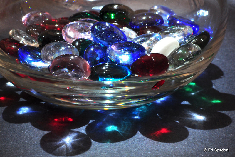 3/2/2011<br /> Baubles, sans seltzer<br /> <br /> The same glass beads but this time in a glass pitcher, dry with a small book-light directly overhead.