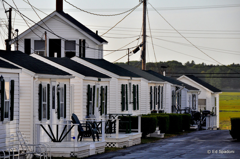"Anticipation<br /> 5/28/2010<br /> A quick stop at Hampton Beach, NH, just days before Memorial Day, which marks the start of the summer season.  These cottages are queued and ready.<br /> <br /> Thanks for all the comments on yesterday's ""trees"" image.  That shot was almost SOOC (just some slight color tone warm up).  I shot it at f22, 1/5 second, and panned up during the exposure.  Sorry that some had trouble with the link to the alt view, for others it seemed to work ok (!)"